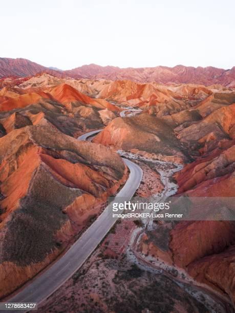red sandstone mountains of different minerals, zhangye danxia geopark, china - 甘粛張掖国家地質公園 ストックフォトと画像
