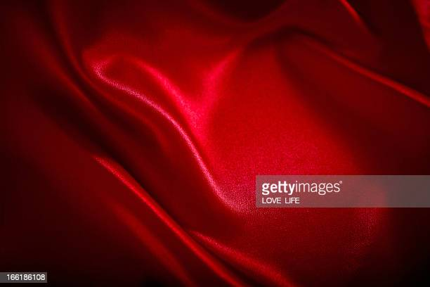 red satin background - valentine's day holiday stock pictures, royalty-free photos & images