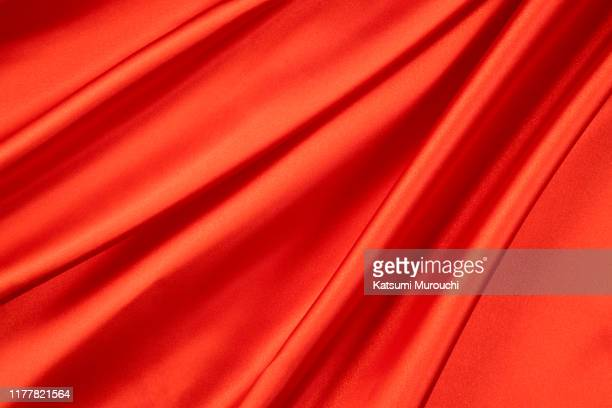 red satin textured background material - 赤 ストックフォトと画像