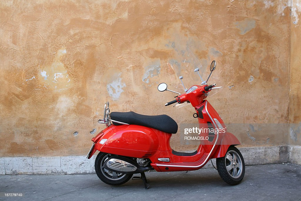 Red scooter and Roman wall, Rome Italy : Stock Photo