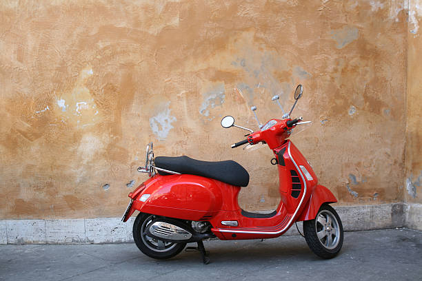 Red scooter and Roman wall, Rome Italy
