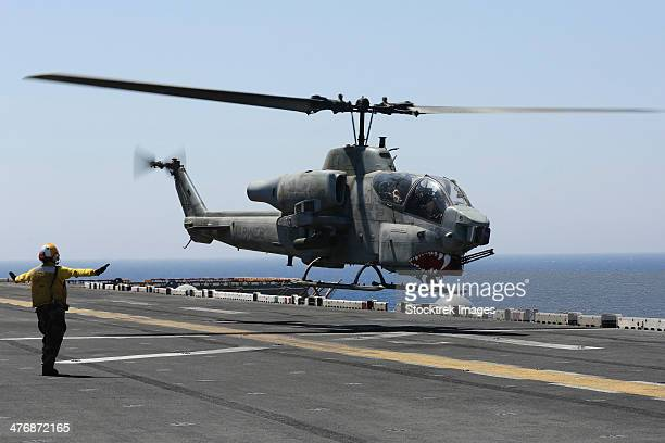 Red Sea, July 23, 2013 - An AH-1W Super Cobra helicopter takes off from the flight deck of the amphibious assault ship USS Kearsarge.