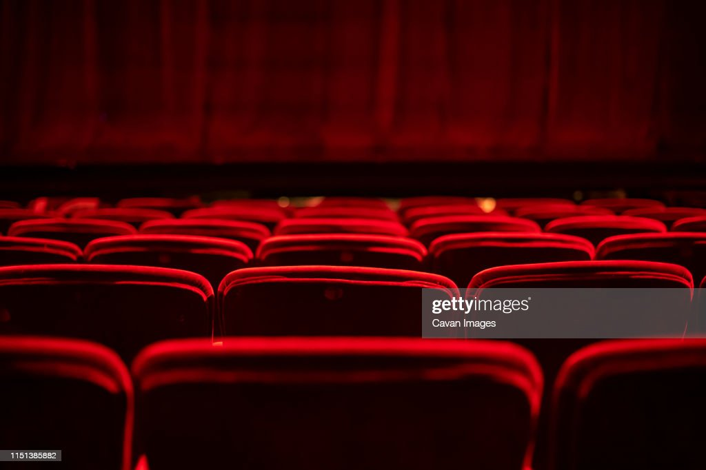 Red seats and curtains of an empty theater : Stock-Foto