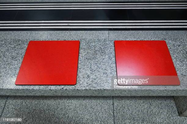 red seats in the railway station ,zurich. - emreturanphoto stock pictures, royalty-free photos & images