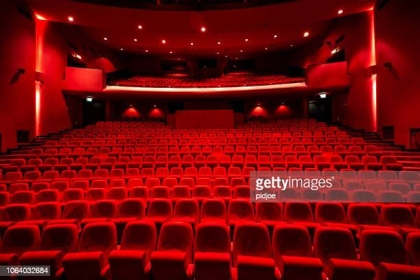 red seats in theather - film festival stock pictures, royalty-free photos & images