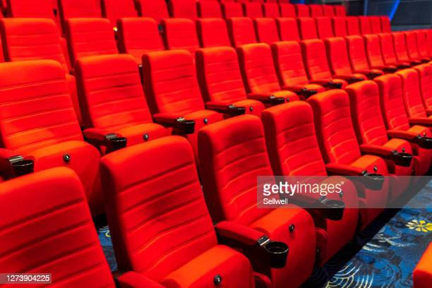 red seats in theather - seat stock pictures, royalty-free photos & images