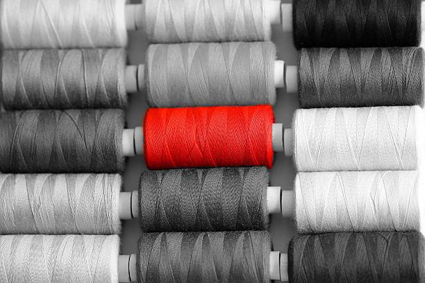Red Sewing Thread Stands Out From Grey Ones Wall Art