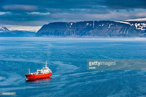 red ship on isafjardardjup, iceland - westfjords iceland stock photos and pictures