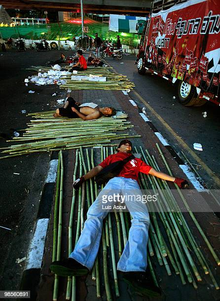 Red Shirt antigovernment protesters sleep at the front line separating Reds and the Thai army in the Silom district as the Red Shirt supporters of...