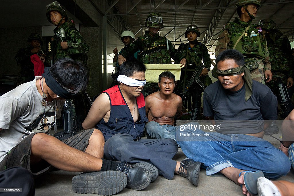Red shirt anti-government protesters surrender to the military inside the red shirt camp on May 19, 2010 in Bangkok, Thailand. At least 5 people are reported to have died as government forces sought to overrun barricades raised in and around the city centre by anti-government protestors. Red-shirt leaders have now surrendered, ending their blockade in the aftermath of a sixth day of violence, leaving the army in control and a night time curfew to be imposed.