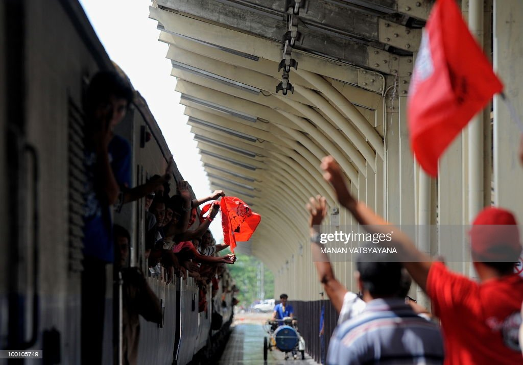 Red Shirt supporters welcome protestors arriving on a train from Bangkok at the train station in Chiang Mai, around 700kms from Bangkok on May 21, 2010. Thailand picked up the pieces after violence and mayhem triggered by a crackdown on anti-government protests, as the focus swung to recovery and reconciliation in a divided nation.