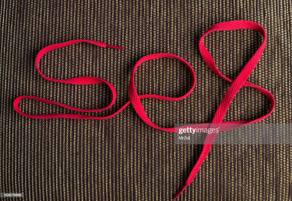 Red shoelaces in sex text : Stock Photo