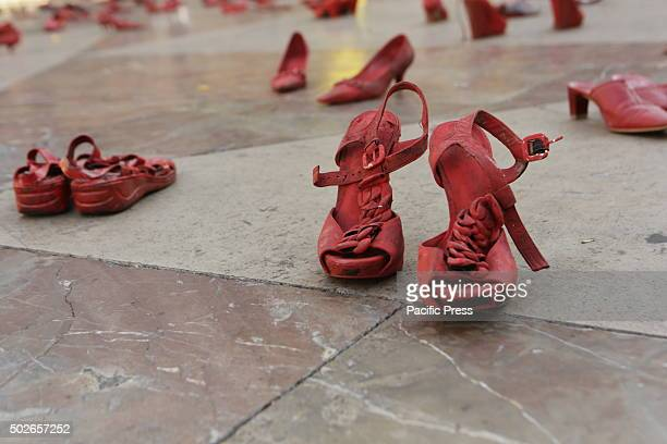 Red shoes have been placed on the Placa de la Verge outside the Cathedral of Valencia Amnesty International placed red shoes at the Placa de la Verge...
