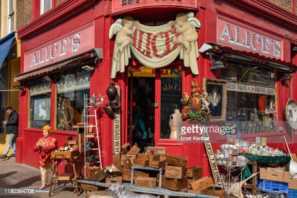 red shop  of souvenirs at portobello road, london uk - greater london stock pictures, royalty-free photos & images