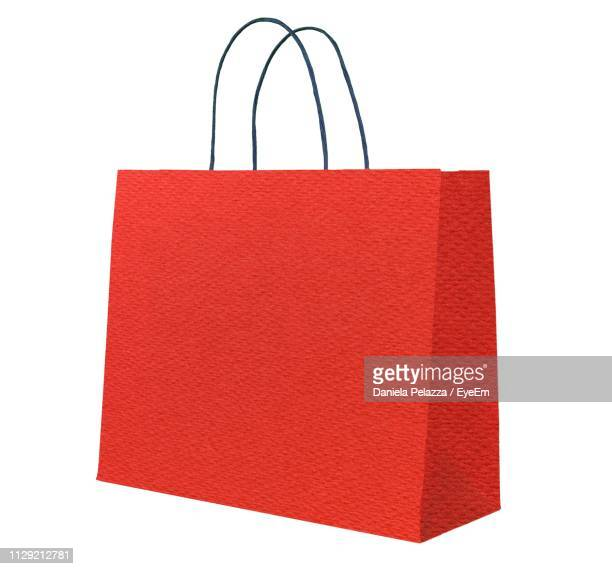 red shopping bag against white background - 買い物袋 ストックフォトと画像