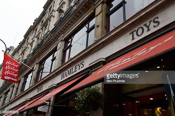 A red sign hang in front of Hamleys retail toy store on October 22 2015 in London England Chinese footwear retailer CBanner International Holdings is...