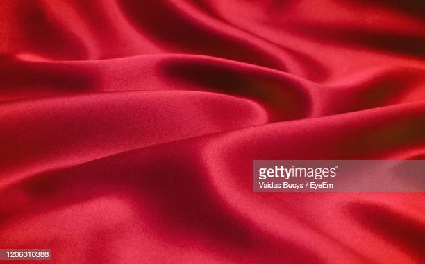 red silk cloth background, abstract fabric texture - ベルベット ストックフォトと画像