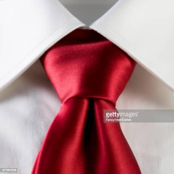 Red silk necktie over white dress shirt