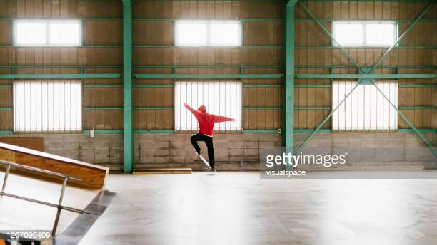 red skateboarder mid-air ollie - ollie pictures stock pictures, royalty-free photos & images