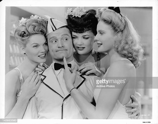 Red Skelton is surrounded by admiring women in a scene from the film 'Thousands Cheer' 1943