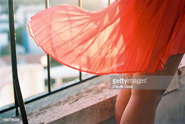 red skirt on the wind - windy skirt stock photos and pictures