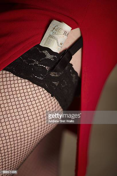 red skirt, stocking tops & a roll of pound notes - lap dance foto e immagini stock