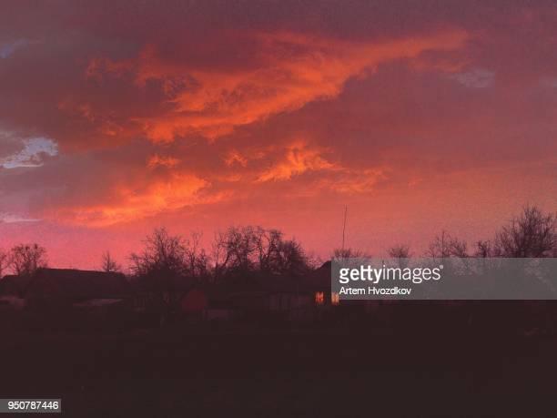 Red skyline in village