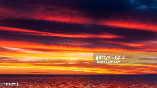 red skys - climat stock pictures, royalty-free photos & images