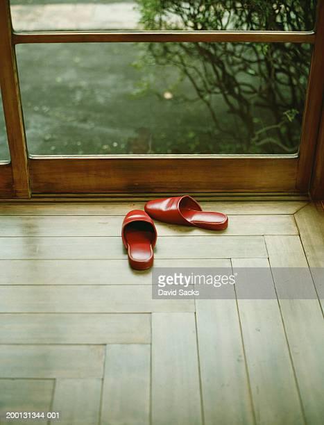 Red slippers near window