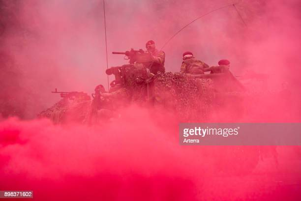 Red smoke curtain and commandos of the ParaCommando Regiment under attack in LRPV armoured vehicle firing mounted machine guns