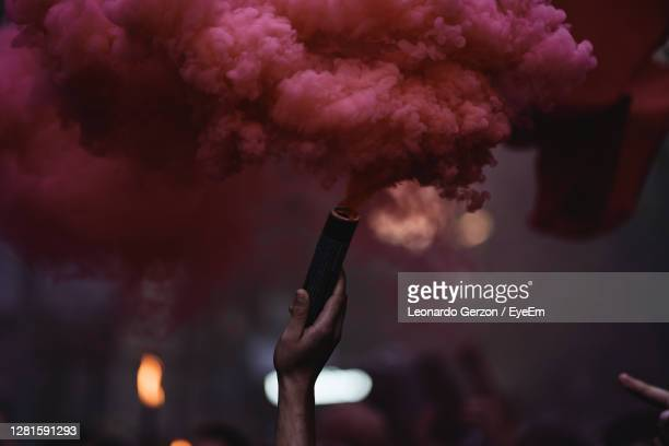 red smoke from a flare - riot stock pictures, royalty-free photos & images