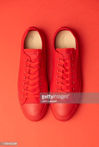 red sneakers - still life not people stock photos and pictures