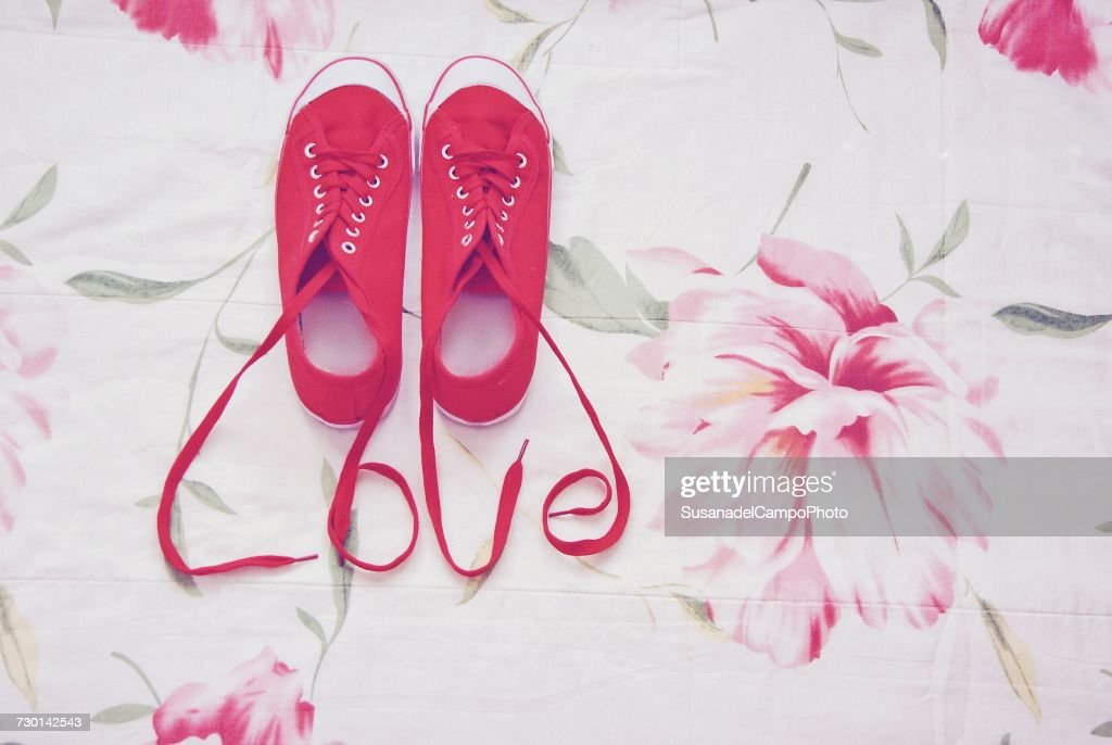 Canvas shoes and shoelaces spelling the word love stock photo keywords publicscrutiny Images