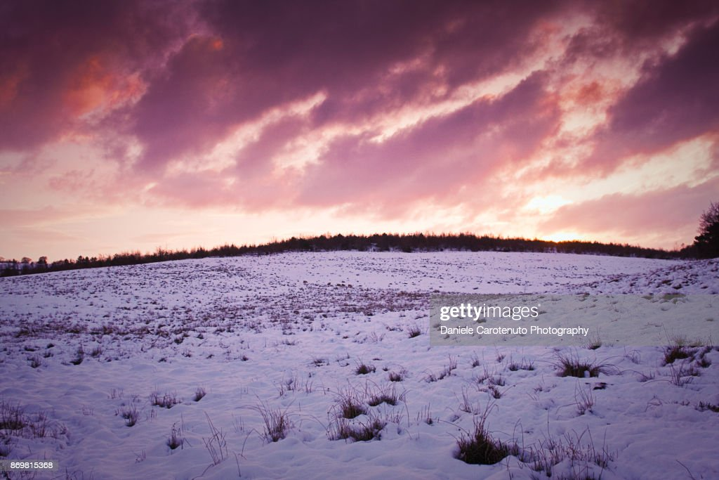 Red snow sky at sunset : Stock Photo