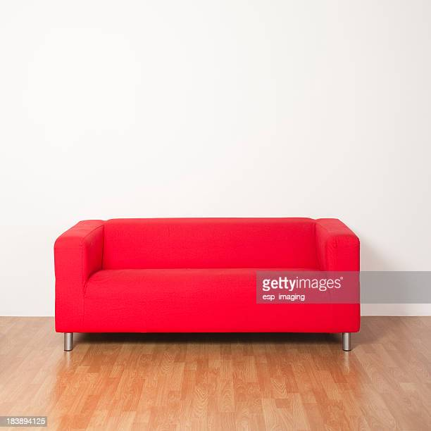 Red sofa against white wall