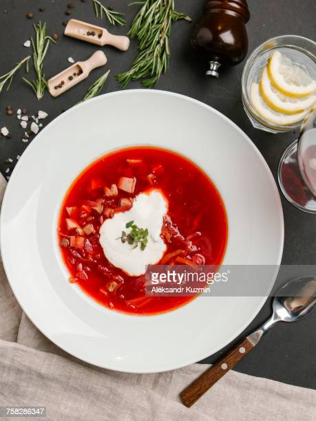 Red soup in bowl with sour cream