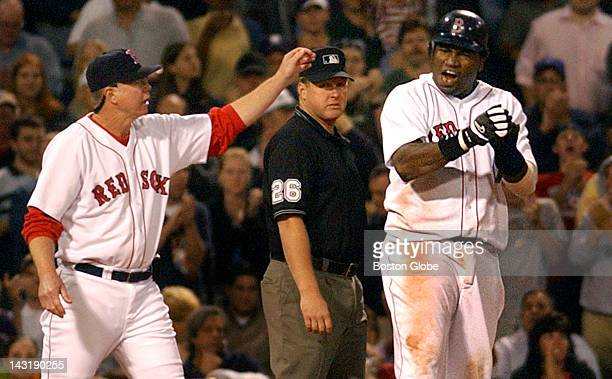 Red Sox 1B David Ortiz howls in delight as he has just pulled into third base safely on Kevin Millar's sixth inning single that scored Manny Ramirez...