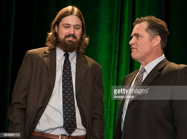 Red Sox Andrew Miller talks to his new manager John Farrell before the Boston Baseball Writers Association Dinner at the Westin Copley Place on...
