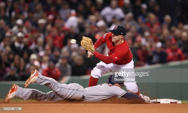 Red Sox Brock Holt about to tag out Astros Alex Bregman stealing second in the third inning Boston Red Sox hosted the Houston Astros in Game One of...