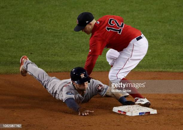 Red Sox Brock Holt tags out Astros Alex Bregman stealing second in the third inning Boston Red Sox hosted the Houston Astros in Game One of ALCS at...