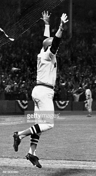 Red Sox catcher Carlton Fisk uses body language as his twelfthinning home run heads for the netting just to the right of the leftfield foul pole to...