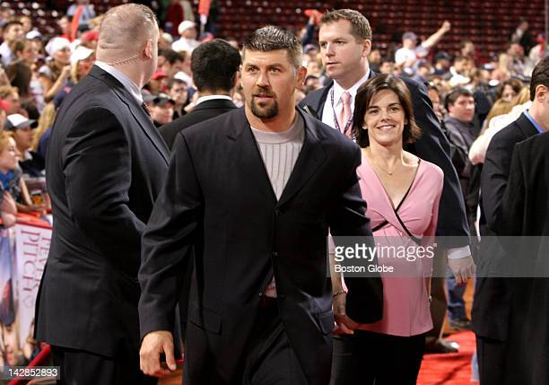 Red Sox catcher Jason Varitek and his wife leave the field following tonight's festivities for opening night of the movie Fever Pitch at Fenway Park
