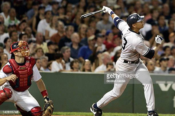 Red Sox catcher Jason Varitek left and the Yankees' Alex Rodriguez right watch the long flight of Rodriguez's top of the ninth inning two run home...