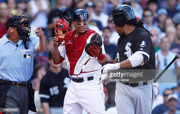 Red Sox catcher Victor Martinez argues a call that resulted in a walk for former Red Sox outfielder, Manny Ramirez , right, on a pitch from closer...