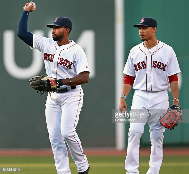 Red Sox centerfielder Jackie Bradley Jr and rightfieder Mookie Betts as Bradley throws a ball back into the infield after fielding a single by a...
