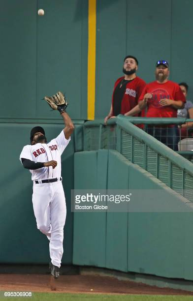 Red Sox centerfielder Jackie Bradley, Jr. Makes the catch while backing up for the final out of the top of the first inning on a fly ball by the...