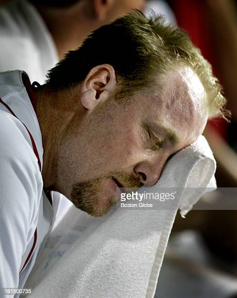 Red Sox closer Curt Schilling is despondent in the dugout after the top of the ninth inning having given up a two run home run to the Yankees' Alex...