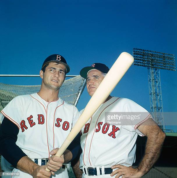 Red Sox coach Bobby Doerr right gives advice to outfielder Carl Yastrzemski October 3rd day before the World Series opener Doerr a former Red Sox 2nd...