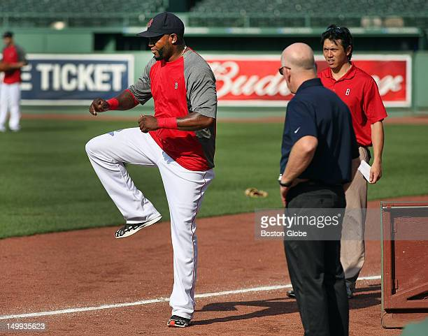 Red Sox David Ortiz under a watchful eye as he does some footwork during an evaluation on the field before the game to see how his injury is healing...
