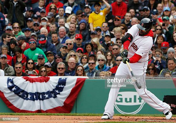 Red Sox designated hitter David Ortiz hits an RBI single against Baltimore during the first inning of the Red Sox Home Opener at Fenway Park in...
